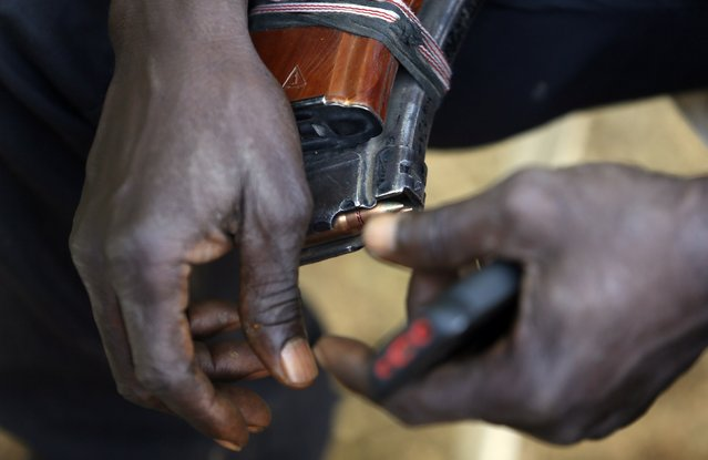 A leader of militia hunters helping the army to fight the Boko Haram insurgence in the northeast region of Nigeria, holds a magazine of bullets in his hands during an interview in Yola, Adamawa State January 14, 2015. (Photo by Afolabi Sotunde/Reuters)