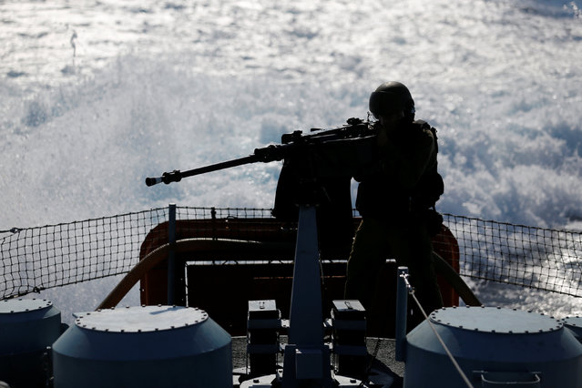 An Israeli soldier fires a machine gun as he takes part in a drill simulating the targeting of an infiltrated enemy vessel and the evacuation of a patrol boat, in the Mediterranean Sea off the coast of Ashdod, southern Israel November 8, 2016. (Photo by Amir Cohen/Reuters)