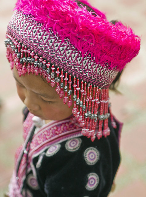 """Her Name is Flower"". Flower is a girl from the Hill Tribes of northern Thailand who, wearing her native costume, comes to Doi Suthep temple, just above Chiang Mai, Thailand, to greet visitors. (Photo and caption by Ileana Oroza/National Geographic Traveler Photo Contest)"