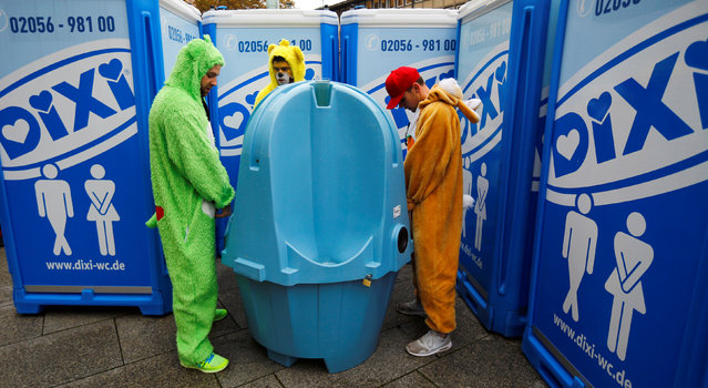 Revellers use a toilet before celebrating the start of the carnival season, a season of controlled raucous fun that reaches a climax during the days before Ash Wednesday and the start of Lent, in Cologne, Germany November 11, 2016. (Photo by Wolfgang Rattay/Reuters)