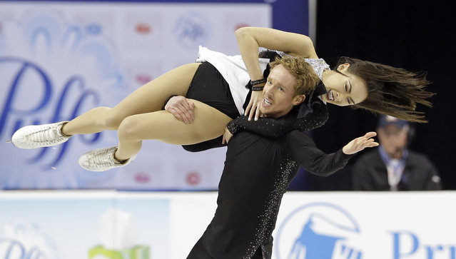 Evan Bates spins Madison Chock as they perform during the free dance program in the U.S. Figure Skating Championships in Greensboro, N.C., Saturday, January 24, 2015. (Photo by Gerry Broome/AP Photo)