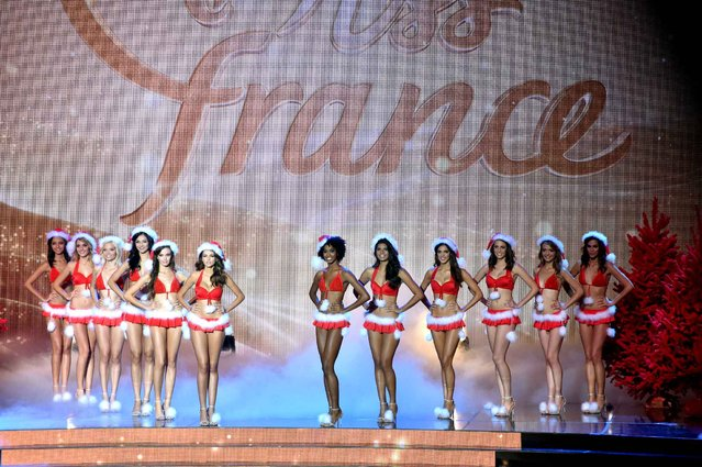 Miss France contestants parade on stage during the Miss France 2016 beauty pageant, on December 19, 2015 in Lille, northern France. (Photo by Philippe Huguen/AFP Photo)