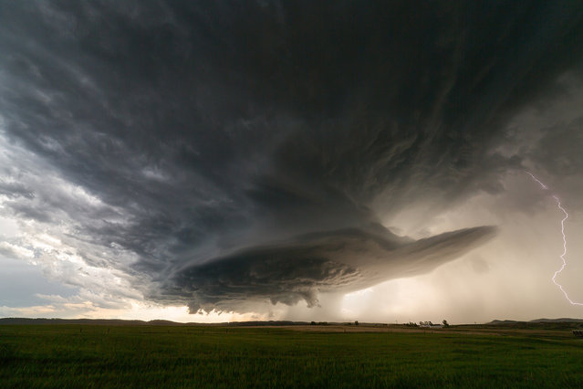This supercell near Rapid City lasted for hours and didn't move more than 15 miles on June 1, 2015 in South Dakota, United States. (Photo by Mike Olbinski/Barcroft Media)