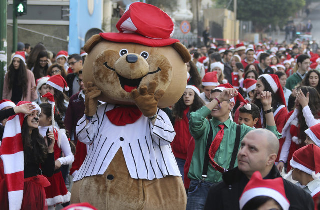 Students wearing festive Christmas costumes take part in a Christmas parade in Beirut, Lebanon, December 22, 2015. (Photo by Aziz Taher/Reuters)