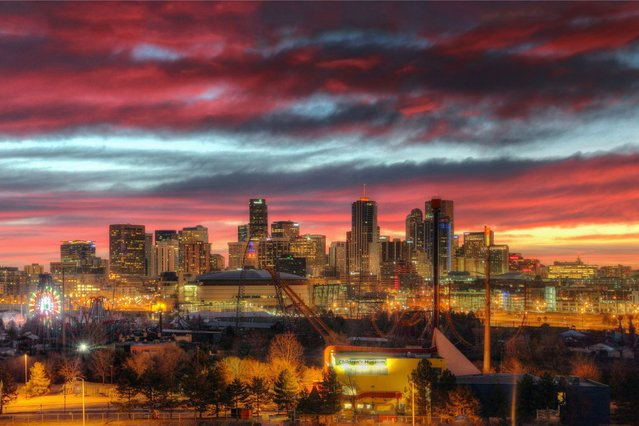 A red sky rises over the city of Denver, Colorado. (Photo by Greg Thow/Barcroft Media)
