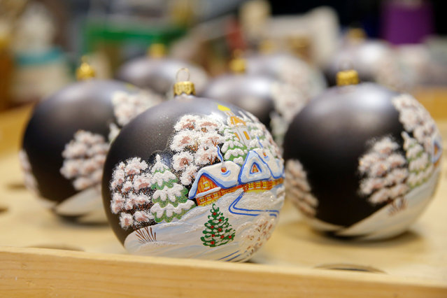 "Painted glass Christmas and New Year decorations are pictured at the ""Yolochka"" (Christmas tree) factory, which has been producing glass decorations and toys for the festive season since 1848, in the town of Klin outside Moscow, Russia, November 24, 2016. (Photo by Maxim Zmeyev/Reuters)"