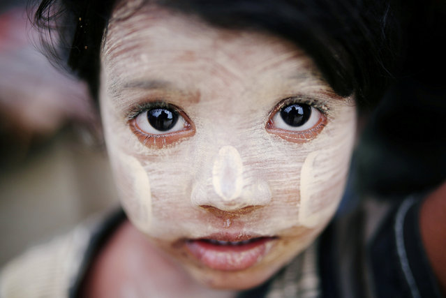 A Rohingya refugee child with thanaka paste is seen in Cox's Bazar, Bangladesh, July 4, 2018. (Photo by Mohammad Ponir Hossain/Reuters)