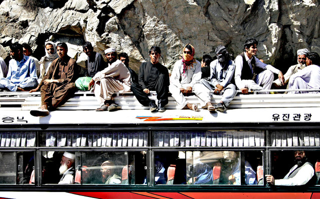 Afghans travel on a bus, on the outskirts of Kabul, Afghanistan, Tuesday, August 27, 2013. (Photo by Ahmad Jamshid/AP Photo)