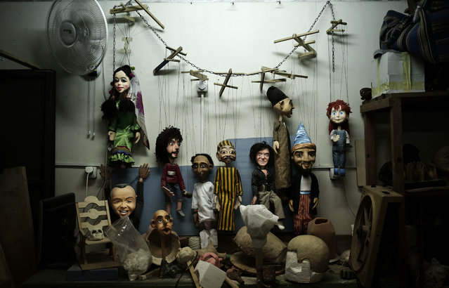 In this April 24, 2018 photo, puppets hang on the wall at the workshop of Egyptian artist Mohamed Fawzi Bakkar, in Cairo, Egypt. Bakkar designs and builds marionettes from scratch, hoping to revive a traditional art. The 32-year-old spends hours or even days designing puppets inspired by Egyptian life – farmers, street vendors, butchers and the occasional celebrity. (Photo by Nariman El-Mofty/AP Photo)