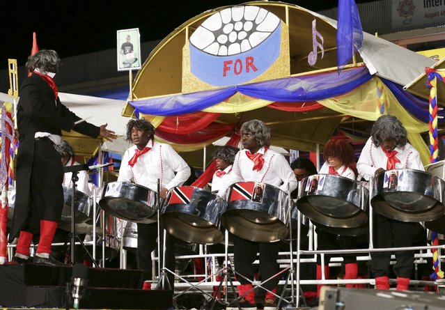 "Members of the T&TEC Tropical Angel harps steelband play ""Pan For Beethoven"" in the large band category during the National Panorama finals held by the governing body Pan Trinbago at the Queen's Park Savannah in Port-of-Spain February 15, 2015. (Photo by Andrea De Silva/Reuters)"
