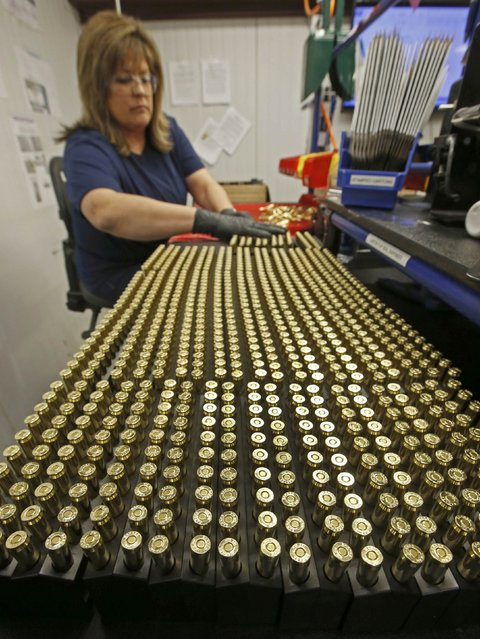 A worker puts finished 300 AAC Blackout rounds into packaging at Barnes Bullets in Mona, Utah, January 6, 2015. (Photo by George Frey/Reuters)