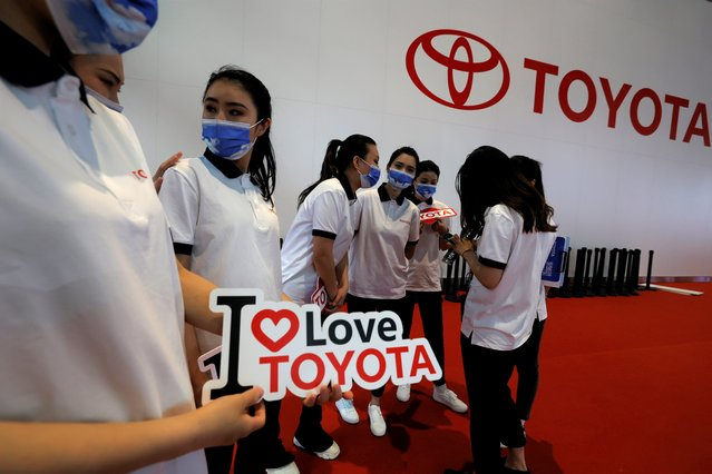 Promoters for Toyota prepare for duty during the Shanghai Auto Show in Shanghai on Monday, April 19, 2021. (Photo by Ng Han Guan/AP Photo)