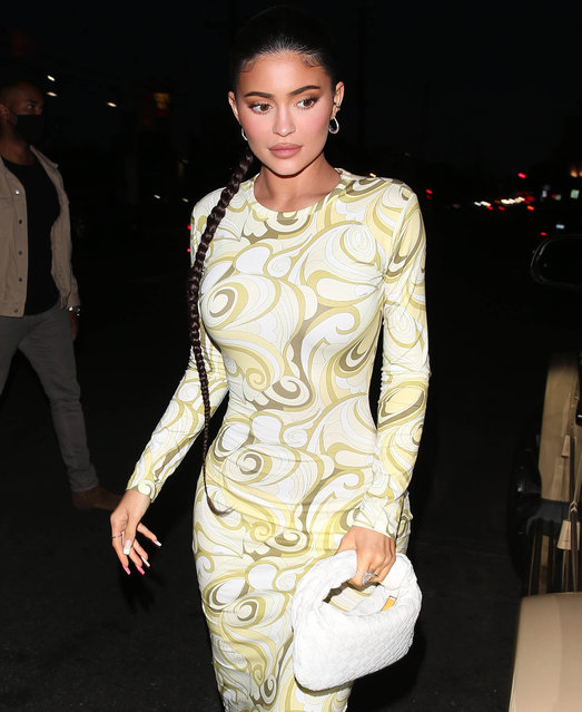 American media personality Kylie Jenner steps out wearing a stunning yellow dress with white boots and white handbag for a Sushi dinner at Nobu in West Hollywood, CA. on April 22, 2021. (Photo by TheRealSPW/The Mega Agency)
