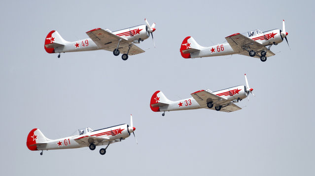 "Russian aerobatic team Yakovlev fly in a formation on the second day of ""Aero India 2015"" at Yelahanka air base in Bangalore, India, Thursday, February 19, 2015. Aviation companies from around the world are participating in the five-day event which runs through Feb. 22. (Photo by Aijaz Rahi/AP Photo)"