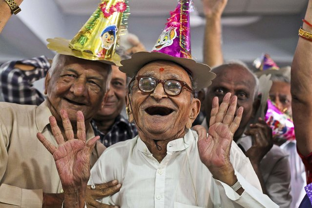 Elderly people participate in celebrations to mark International Day of Older Persons at an old age home in Ahmadabad, India, on October 1, 2013. (Photo by Ajit Solanki/Associated Press)