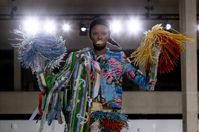 A model presents a creation from the Spring/Summer 2019 Women's collections by US designer Thom Browne during the Paris Fashion Week, in Paris, France, 30 September 2018. (Photo by Etienne Laurent/EPA/EFE)