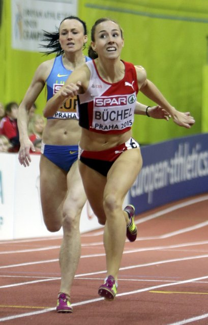 Selina Buchel of Switzerland runs in front of Nataliya Lupu of Ukraine (L) during their women's 800 metres final during the European Indoor Championships in Prague March 8, 2015. REUTERS/David W Cerny (CZECH REPUBLIC  - Tags: SPORT ATHLETICS)
