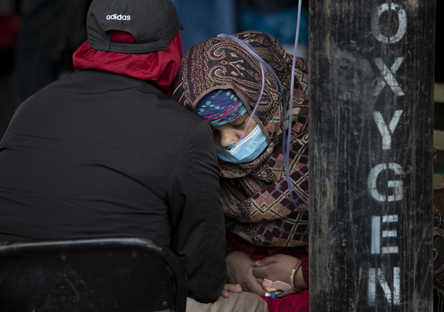 A COVID-19 patient receives oxygen outside an emergency ward at a government run hospital in Kathmandu, Nepal, Thursday, May 13, 2021. (Photo by Niranjan Shrestha/AP Photo)