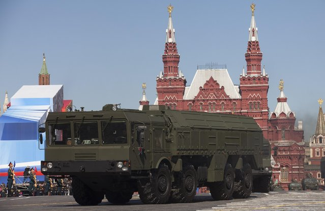 In this Tuesday, May 7, 2013 file photo, Russian Iskander missiles make their way through Red Square during a rehearsal for the Victory Day military parade in Moscow, Russia.  (Photo by Alexander Zemlianichenko/AP Photo)