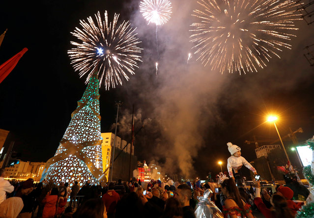 Fireworks explode during a Christmas tree lighting in downtown Beirut, Lebanon December 17, 2016. (Photo by Mohamed Azakir/Reuters)