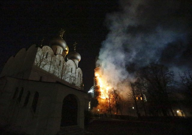 The bell tower of Novodevichy monastery, a UNESCO World Heritage site, burns as it is engulfed in flames in Moscow March 15, 2015. (Photo by Tatyana Makeyeva/Reuters)