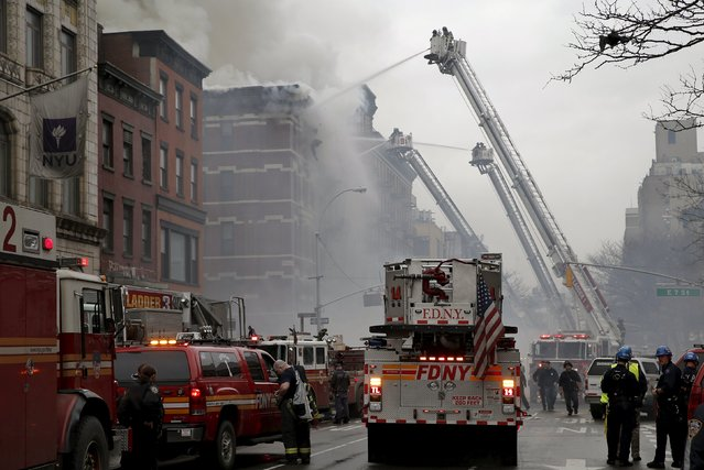New York City Fire Department firefighters work at the site of a residential apartment building collapse and fire in New York City's East Village neighborhood March 26, 2015. (Photo by Mike Segar/Reuters)