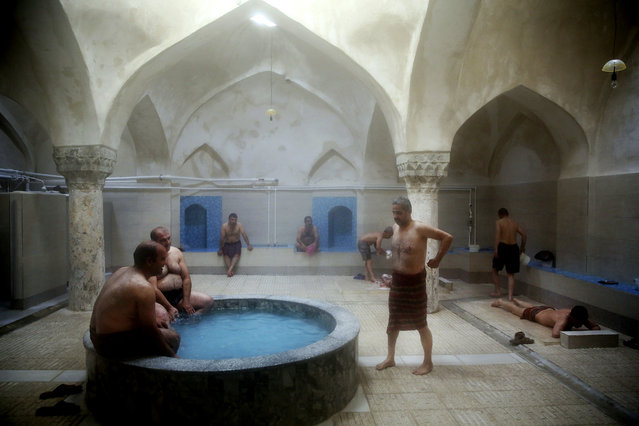 In this October 15, 2014 photo, a group of men bathe at the Nezafat public bathhouse, in Tabriz, Iran. (Photo by Ebrahim Noroozi/AP Photo)