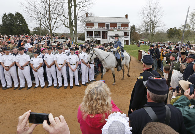 Thomas Lee Jessee, portraying Confederate General Robert E. Lee, leaves the McLean house after meeting with Union Gen. Ulysses S. Grant as part of  commemoration of the 150th anniversary of the surrender of the Army of Northern Virginia at Appomattox Court House in Appomattox, Va., Thursday, April 9, 2015. (Photo by Steve Helber/AP Photo)
