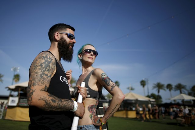 Dominic DeBonis, 31, (L) and Samantha Harris-Roberts, 41, from Somerset, England, walk through the Coachella Valley Music and Arts Festival in Indio, California April 10, 2015. (Photo by Lucy Nicholson/Reuters)