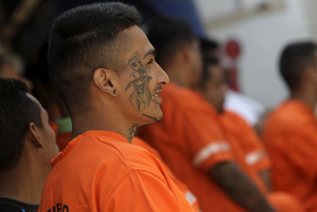 An inmate with a tattoo of Santa Muerte (The Saint of Death) looks on in the Topo Chico prison, during a media tour, in Monterrey, Mexico, February 17, 2016. (Photo by Daniel Becerril/Reuters)