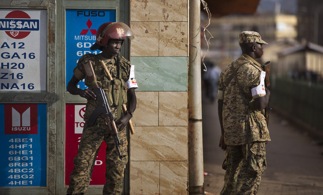 Ugandan military police deploy on the streets shortly after the election result was announced, in downtown Kampala, Uganda Saturday, February 20, 2016. (Photo by Ben Curtis/AP Photo)