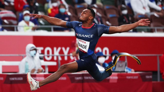 France's Dimitri Pavade competes in the men's long jump T64 final during the Tokyo 2020 Paralympic Games at the Olympic Stadium in Tokyo on September 1, 2021. (Photo by Athit Perawongmetha/Reuters)