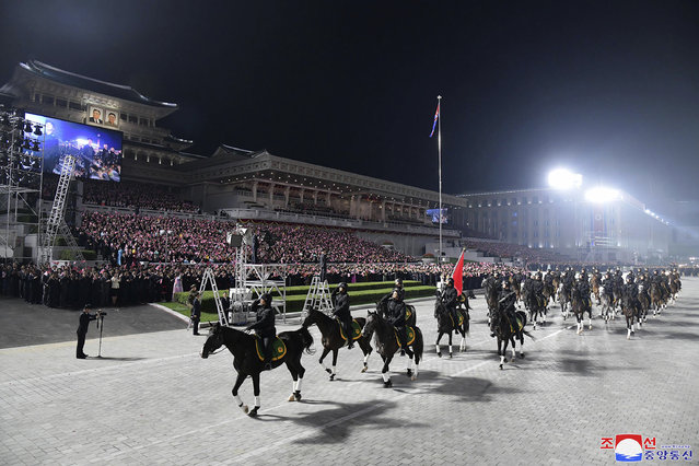 In this photo provided by the North Korean government, North Korean soldiers on horses parade during a celebration of the nation's 73rd anniversary that was overseen by leader Kim Jong Un, at Kim Il Sung Square in Pyongyang, North Korea, early Thursday, September 9, 2021. (Photo by Korean Central News Agency/Korea News Service via AP Photo)