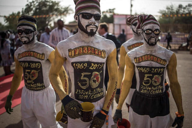 Performers arrive to the entrance of the venue where the opening ceremony of the FESPACO Panafrican Film and Television Festival of Ouagadougou is about to start, on February 23, 2019. Africa's biggest film festival marks its 50th anniversary, buoyed by its contributions to the continent's cinema industry but overshadowed by security problems in host country Burkina Faso. (Photo by Marco Longari/AFP Photo)