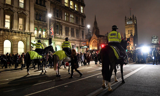 Police officers monitor a protest against U.S. President Donald Trump's executive order travel ban in London, Britain January 30, 2017. (Photo by Dylan Martinez/Reuters)