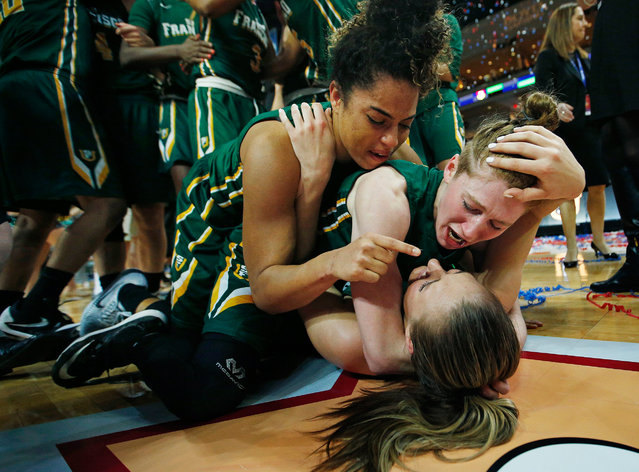 San Francisco guard Zhane Dikes, top, San Francisco guard Rachel Howard, center, and San Francisco forward Taylor Proctor, bottom, celebrate after they defeated BYU in an NCAA college basketball game in the championship of the West Coast Conference tournament, Tuesday, March 8, 2016, in Las Vegas. (Photo by John Locher/AP Photo)