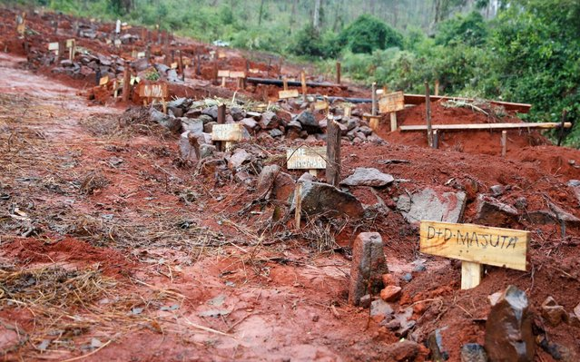 The graves of people killed during Cyclone Idai are seen in Chimanimani, Zimbabwe, March 23, 2019. (Photo by Philimon Bulawayo/Reuters)