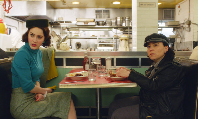 "This image released by Amazon shows Rachel Brosnahan, left, and Alex Borstein in a scene from ""The Marvelous Mrs. Maisel"". On Thursday, Dec. 6, 2018, Borstein was nominated for a Golden Globe award for supporting actress in a series, limited series or TV movie for her role. The 76th Golden Globe Awards will be held on Sunday, Jan. 6. (Photo Amazon via AP Photo)"