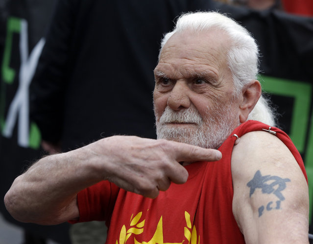 A demonstrator sports a tattoo showing the symbol of the Italian Communist party during a protest against the Expo 2015 fair in Milan, Italy, Friday, May 1, 2015. (Photo by Luca Bruno/AP Photo)