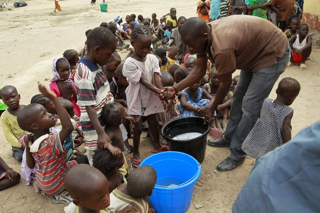 Children rescued from Boko Haram in Sambisa forest wash their hands at the Malkohi camp for Internally Displaced People in Yola, Adamawa State, Nigeria, May 3, 2015. (Photo by Afolabi Sotunde/Reuters)