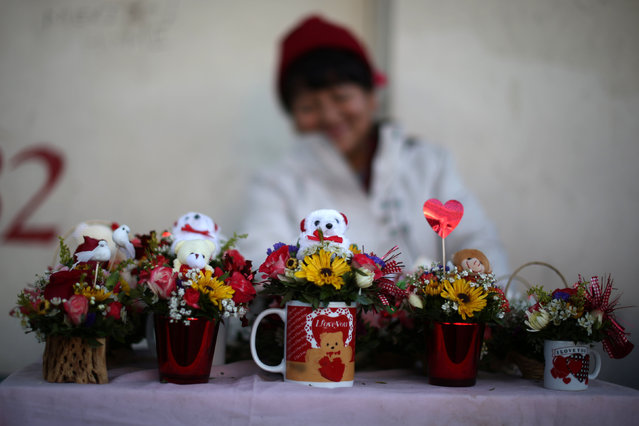 A woman sells Valentine's Day gifts in Los Angeles, U.S. February 14, 2017. (Photo by Lucy Nicholson/Reuters)