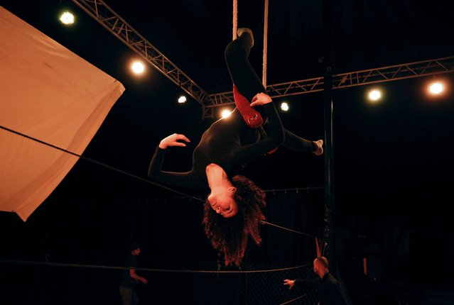 A Palestinian woman trains at the Palestinian Circus School in the village of Bir Zeit, in the Israeli occupied West Bank near Ramallah on March 21, 2016, as they continue to perform in support of their trainer Muhammad Abu Sakha who is in an Israeli jail under administrative detention. Circus performers around the world are mobilising in support of Sakha, the Palestinian clown and teacher, held by Israel without trial for more than three months on unspecified grounds. (Photo by Abbas Momani/AFP Photo)