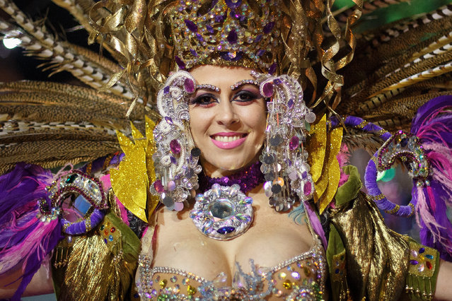 A member of 'Bahia Bahitiare' troupe performs in the troupes dancing contest during the Santa Cruz de Tenerife Carnival on March 1, 2014 in Santa Cruz de Tenerife on the Canary island of Tenerife, Spain. The Carnival of Santa Cruz de Tenerife brings thousands of revellers every year. Santa Cruz is the closest European equivalent to the Brazilian Carnival from Rio de Janeiro.  (Photo by Pablo Blazquez Dominguez/Getty Images)