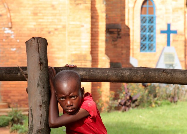 A child plays in a church in Buye a rural town north of capital Bujumbura, Burundi in this picture taken May 1, 2015. (Photo by Edmund Blair/Reuters)