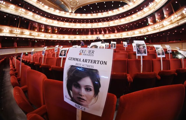 """Seat markers with faces of nominees are seen in position during the """"heads on sticks"""" photocall ahead of the Olivier Awards, which takes place on Sunday at The Royal Opera House on March 29, 2016 in London, England. (Photo by Stuart C. Wilson/Getty Images)"""
