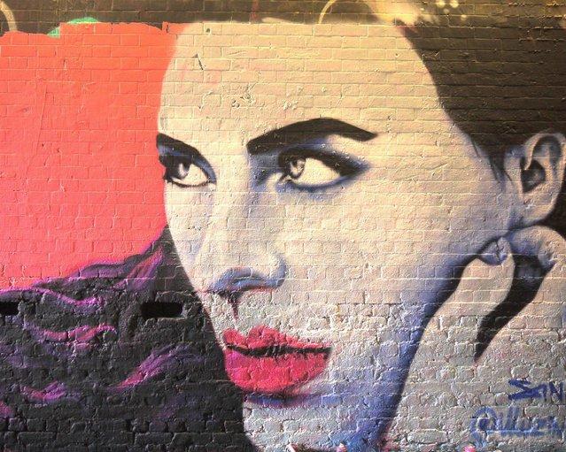 Mural by female street artist Zina. (Photo by Dez Mighty/Susan Mackey)