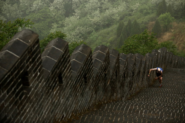 A runner competes in the Great Wall Marathon at the Huangyaguan Great Wall outside Beijing, China, May 18, 2019. (Photo by Thomas Peter/Reuters)