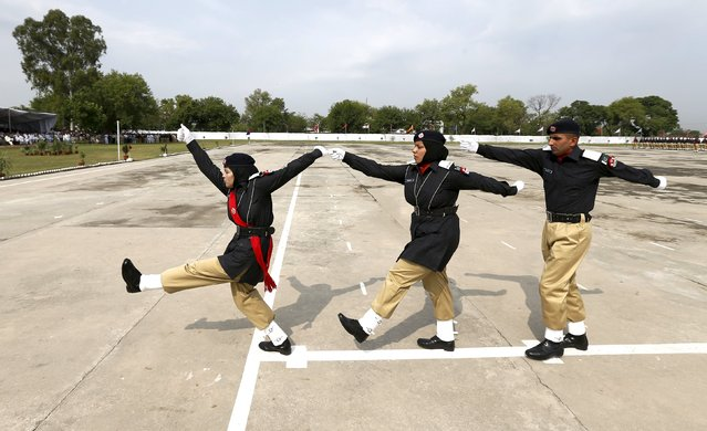 Police academy graduates march during their graduation ceremony in Islamabad, Pakistan May 18, 2015. Out of the 408 graduating officers, 76 female officers were inducted into the Pakistan police force, according to the police force. (Photo by Caren Firouz/Reuters)