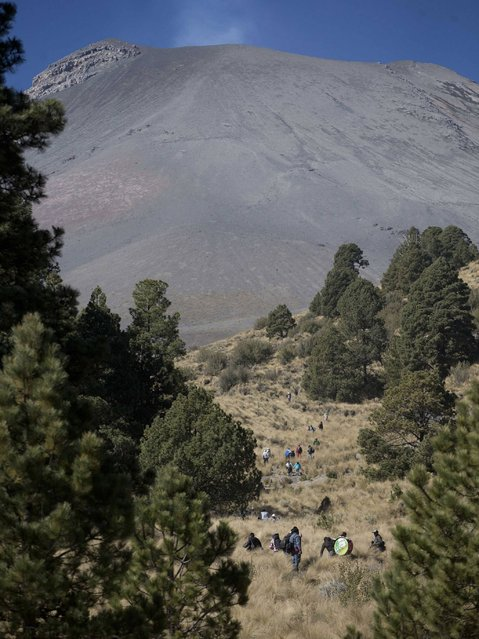 People from the villages surrounding the Popocatepetl volcano make their yearly pilgrimage up the volcano in Mexico. (Photo by Eduardo Verdugo/AP Photo)