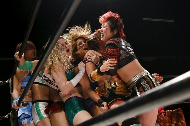 Wrestlers fight during their Stardom female professional wrestling show at Shinkiba 1st Ring in Tokyo, Japan, December 6, 2015. (Photo by Thomas Peter/Reuters)